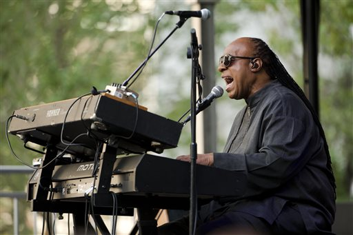 """Musician Stevie Wonder performs during a free pop-up concert Monday, Aug. 17, 2015, outside City Hall in Philadelphia. The concert is part of a news conference promoting Wonder's """"Songs in the Key of Life Performance"""" tour.  (AP Photo/Matt Rourke)"""
