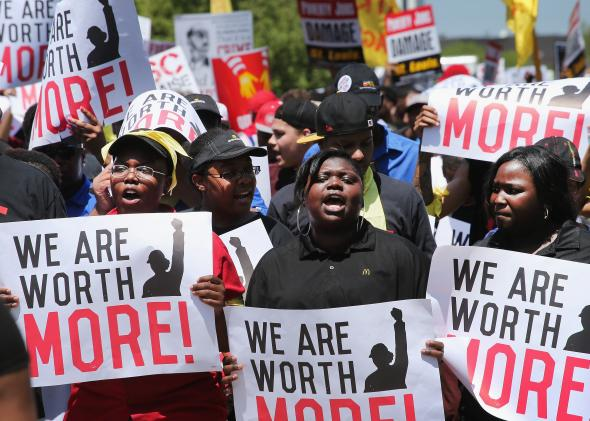 492723115-fast-food-workers-and-activists-demonstrate-outside-the.jpg.CROP.promo-mediumlarge